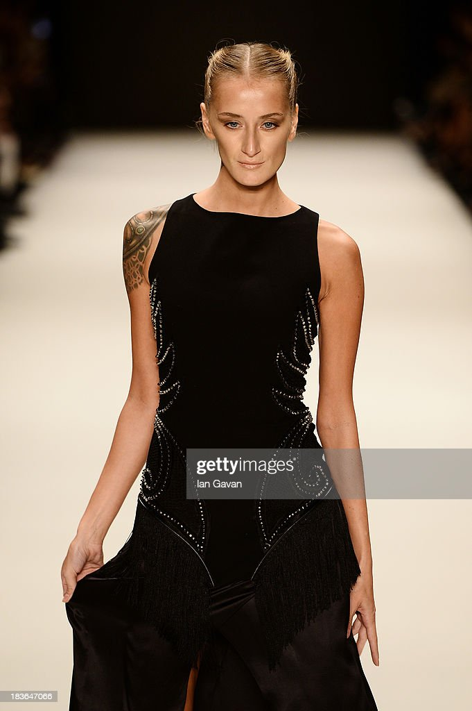 Model Didem Soydan walks the runway at the Lug Von Siga show during Mercedes-Benz Fashion Week Istanbul s/s 2014 presented by American Express on October 8, 2013 in Istanbul, Turkey.