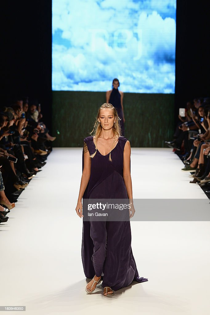Model Didem Soydan walks the runway at the Nej show during Mercedes-Benz Fashion Week Istanbul s/s 2014 Presented By American Express on October 10, 2013 in Istanbul, Turkey.