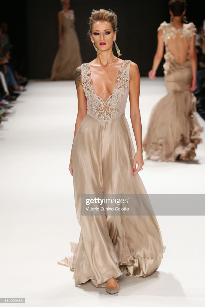 Model Didem Soydan walks the runway at the Odrella show during Mercedes-Benz Fashion Week Istanbul s/s 2014 Presented By American Express on October 11, 2013 in Istanbul, Turkey.