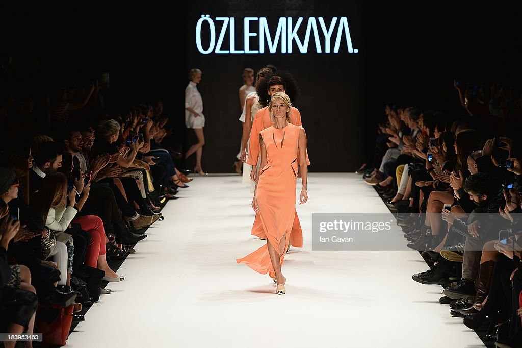 Model Didem Soydan walks the runway at the Ozlem Kaya show during Mercedes-Benz Fashion Week Istanbul s/s 2014 Presented By American Express on October 10, 2013 in Istanbul, Turkey.