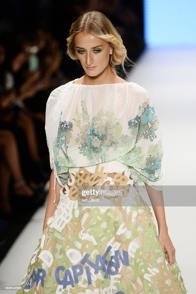 Model Didem Soydan walks the runway at the Red Beard By Tanju Babacan show during Mercedes-Benz Fashion Week Istanbul s/s 2014 presented by American Express on October 8, 2013 in Istanbul, Turkey.