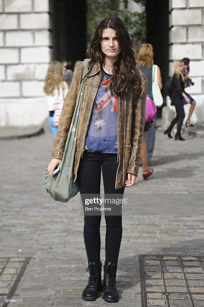 Model Dillon poses wearing vintage jacket topshop tshirt Rag and Bone trousers and Zadig Voltaire shoes at Somerset House on day 1 London Fashion...