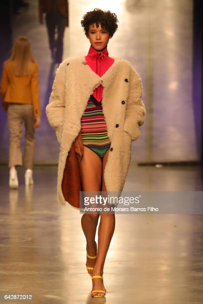 Model Dilone walks the runway at the Topshop Unique show during the London Fashion Week February 2017 collections on February 19 2017 in London...
