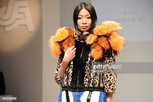 A model dispays a fur creation designed by a fashion school student Saeko Kato at the annual fur design contest in Tokyo on November 28 2013 Kato...