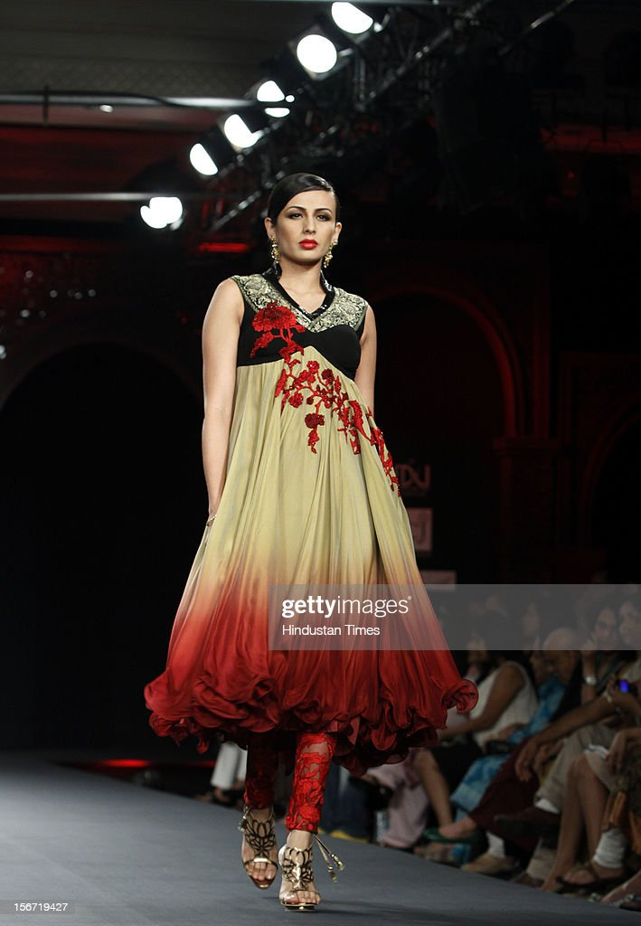 'NEW DELHI,INDIA -AUGUST 8: A model display a creation of designer Varun Bahl at the PCJ Delhi Couture week 2012 in New Delhi,India. (Photo by M Zhazo/Hindustan Times via Getty Images)'