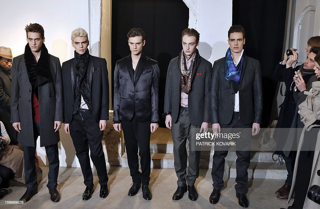 Model display creations by Brazilian designer Gustavo Lins on January 18, 2013 during the men's fall-winter 2013-2014 fashion week in Paris.
