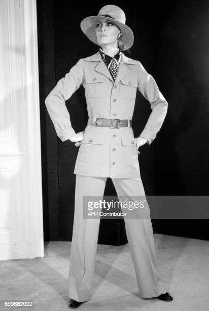 A model displays 08 February 1969 in Paris an écru gabardine trouserss suit with sleeveblouse large patchpockets military styled and strawhat for...