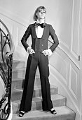A model displays 15 February 1967 in Paris an alpaca dinner jacket spencer jabot blouse and black silk bowtie for Yves Saint Laurent 1967...