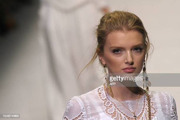 A model displays a creation as part of Dolce Gabbana springsummer 2011 readytowear collection on September 26 2010 during the Women's fashion week in...