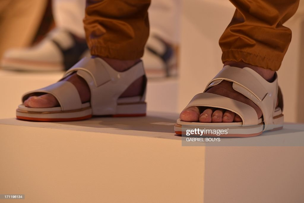 A model displays a creation as part of Salvatore Ferragamo Spring-Summer 2014 Menswear collection on June 23, 2013 during the fashion week in Milan.