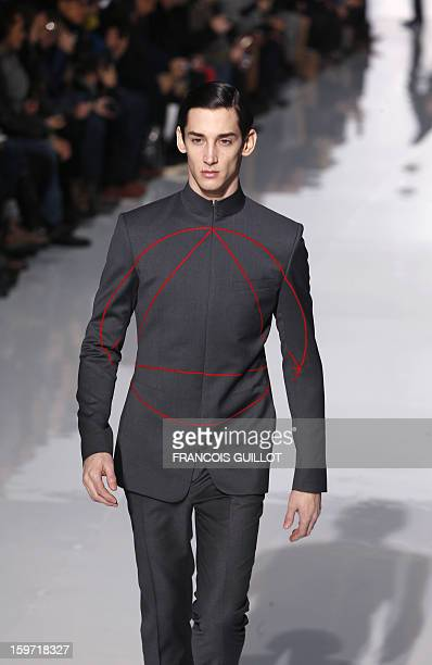 A model displays a creation by Belgian designer Kris Van Assche for the label Dior during the men's FallWinter 20132014 collection show on January 19...