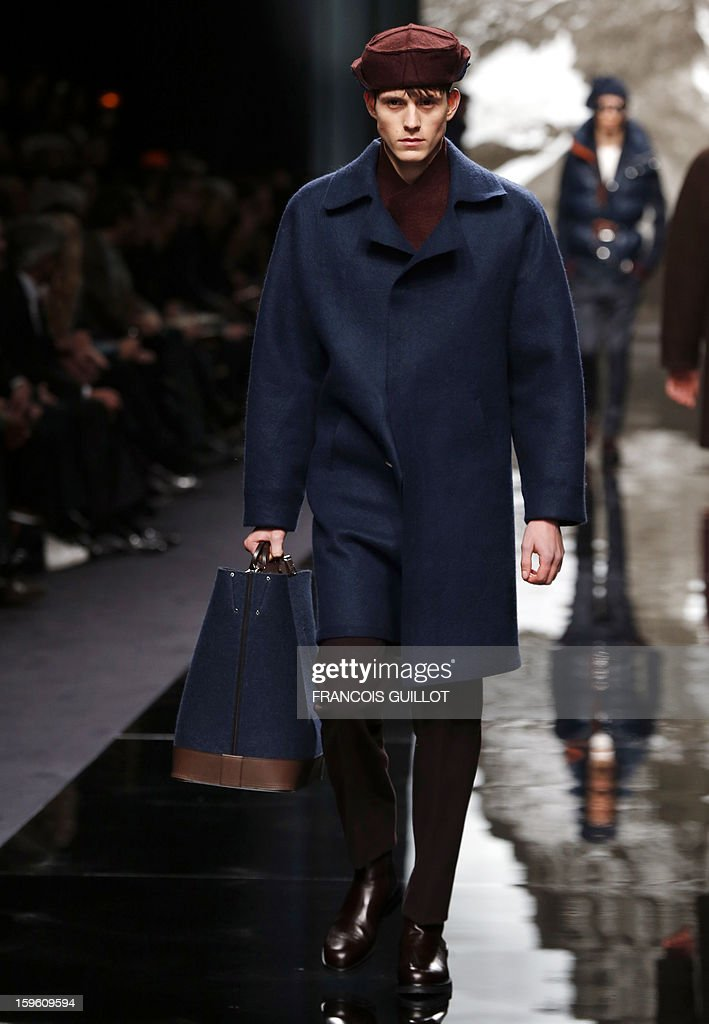 A model displays a creation by British designer Kim Jones for Louis Vuitton during the men's Fall-Winter 2013-2014 collection show on January 17, 2013 during the Men's fashion week in Paris. AFP PHOTO / FRANCOIS GUILLOT