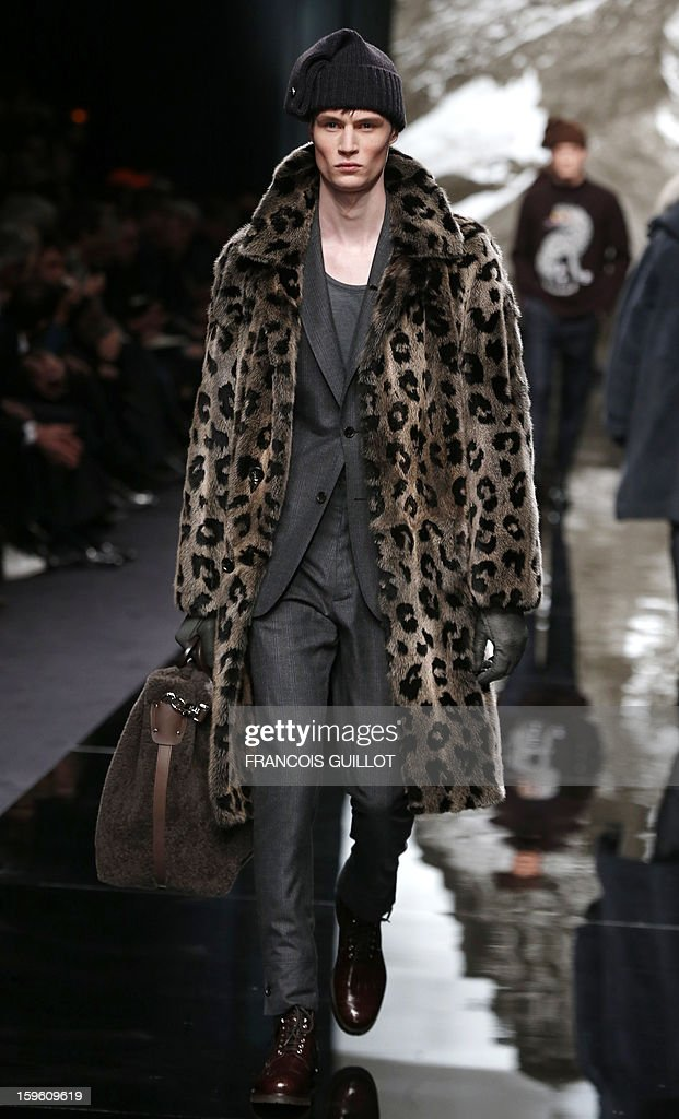 A model displays a creation by British designer Kim Jones for Louis Vuitton during the men's Fall-Winter 2013-2014 collection show on January 17, 2013 during the Men's fashion week in Paris.