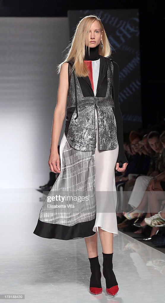 A model displays a creation by ComeFromBreakfast during 'Who Is On Next?' Altaroma Vogue Italia fashion show as part of AltaRoma AltaModa Fashion Week at Santo Spirito In Sassia on July 8, 2013 in Rome, Italy.