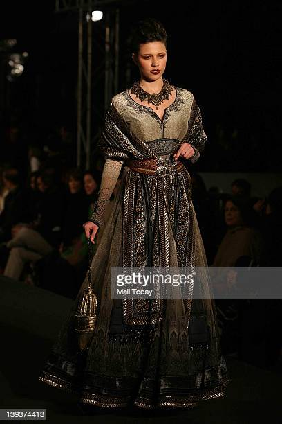 A model displays a creation by designer Tarun Tahiliani on Day 2 of the Wills Lifestyle India Fashion Week 2012 at Blue Frog Mehrauli Delhi