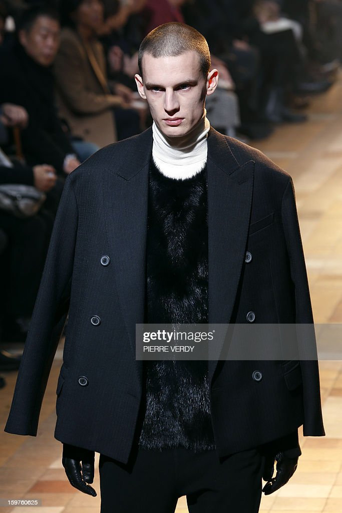 A model displays a creation by Dutch designer Lucas Ossendrijver and Moroccan-born Israeli designer Alber Elbaz for the label Lanvin during the men's Fall-Winter 2013-2014 collection show on January 20, 2013 as part of the Men's fashion week in Paris.