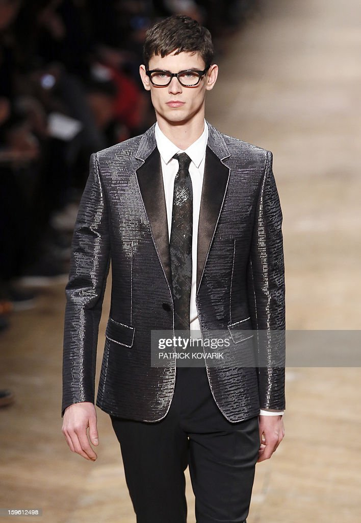 A model displays a creation by Dutch designers Viktor Horsting and Rolf Snoeren for the label Victor and Rolf during the men's Fall-Winter 2013-2014 collection show on January 17, 2013, during the Men's fashion week in Paris.