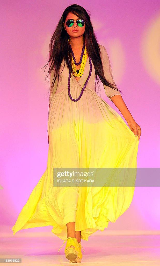 A model displays a creation by fashion designer AOD at the Sri Lanka Design Festival fashion show in Colombo on October 10, 2013. AFP PHOTO/ Ishara S. KODIKARA