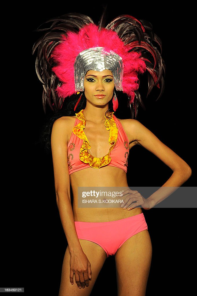 A model displays a creation by fashion designer Sonali at the annual HSBC Resort fashion week in Galle on October 6, 2013. Designers from Sri Lanka, India, Pakistan and Bangladesh were among the dozens of fashion designers who displayed their work at the 2-day event that began on October 5. AFP PHOTO/ Ishara S.KODIKARA