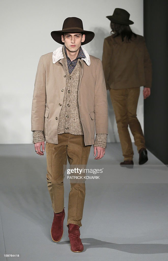 A model displays a creation by French designer Agnes B on January 20, 2013 during the men's fall-winter 2013-2014 fashion week in Paris.