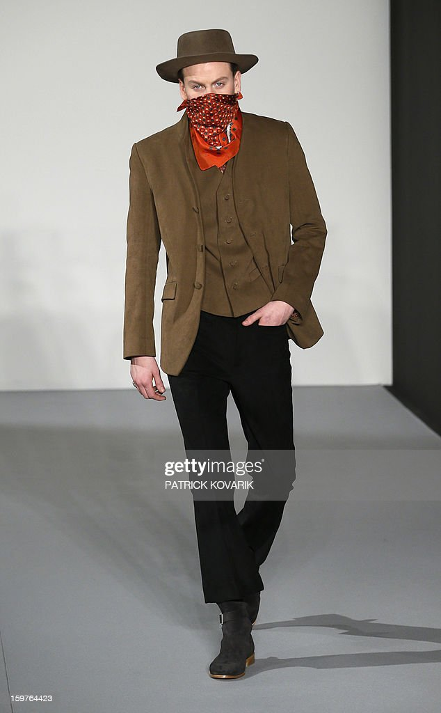 A model displays a creation by French designer Agnes B on January 20, 2013 during the men's fall-winter 2013-2014 fashion week in Paris. AFP PHOTO / PATRICK KOVARIK