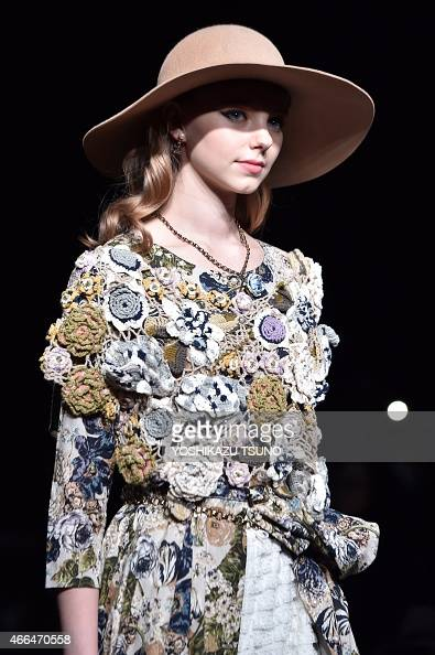 A model displays a creation by Japanese designer Hiroki Uemura during the 'byU' 201516 autumn/winter collection at Tokyo Fashion Week on March 16...