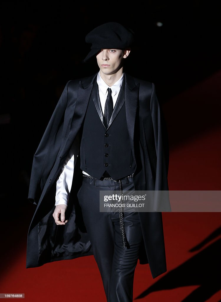 A model displays a creation by Japanese designer Rynshu on January 20, 2013 during the men's fall-winter 2013-2014 fashion week in Paris.
