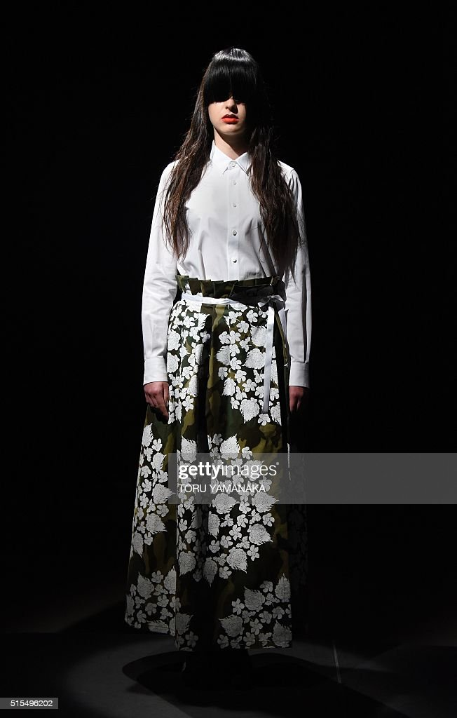 A model displays a creation by japanese designer tsukasa Japanese clothing designers