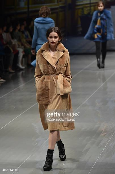 A model displays a creation by Japanese designer Yuki Torii during her 201516 autumn/winter collection in Tokyo on March 20 2015 as a part of Tokyo...