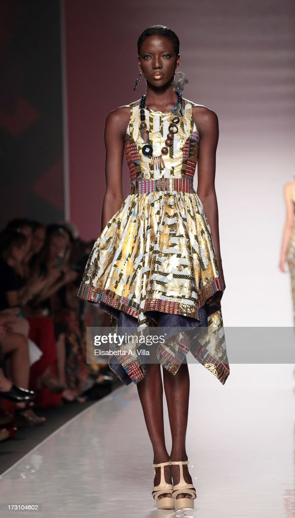 A model displays a creation by Kiki Clothing during It's Ethical Fashion 'Bring Africa to Rome' catwalk collection S/S 2014 fashion show as part of AltaRoma AltaModa Fashion Week at Santo Spirito In Sassia on July 7, 2013 in Rome, Italy.
