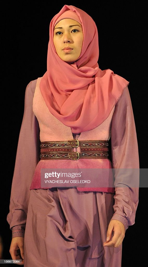 A model displays a creation by Kyrgyz designer Bakyt Beshbayev during a Muslim fashion in the Kyrgyzstan's capital Bishkek, late on November 22, 2012.
