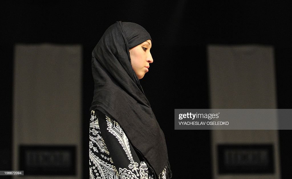 A model displays a creation by Kyrgyz designer Saltanat Mamyrbayeva during a Muslim fashion in the Kyrgyzstan's capital Bishkek, late on November 22, 2012.