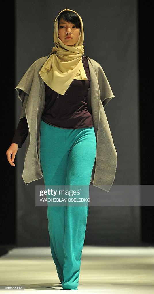 A model displays a creation by Kyrgyz designer Ukey Murataliyva during a Muslim fashion in the Kyrgyzstan's capital Bishkek, late on November 22, 2012.