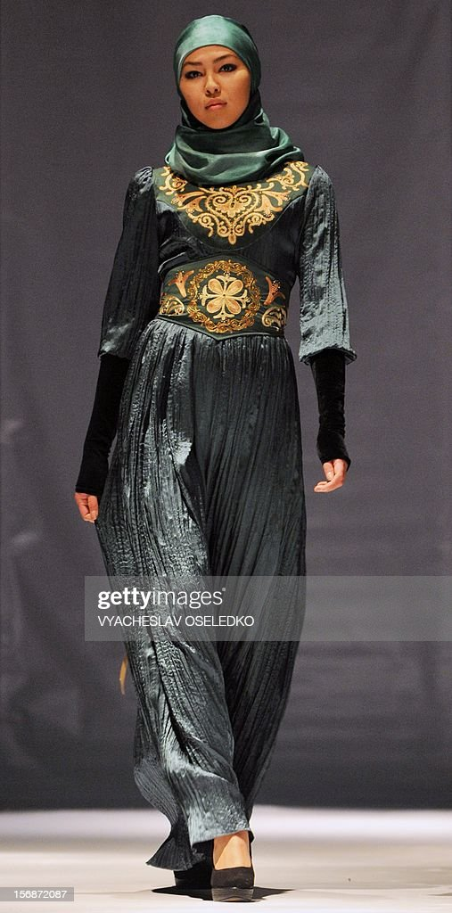 A model displays a creation by Kyrgyz designer Zhanara Chyngysheva during a Muslim fashion in the Kyrgyzstan's capital Bishkek, late on November 22, 2012.