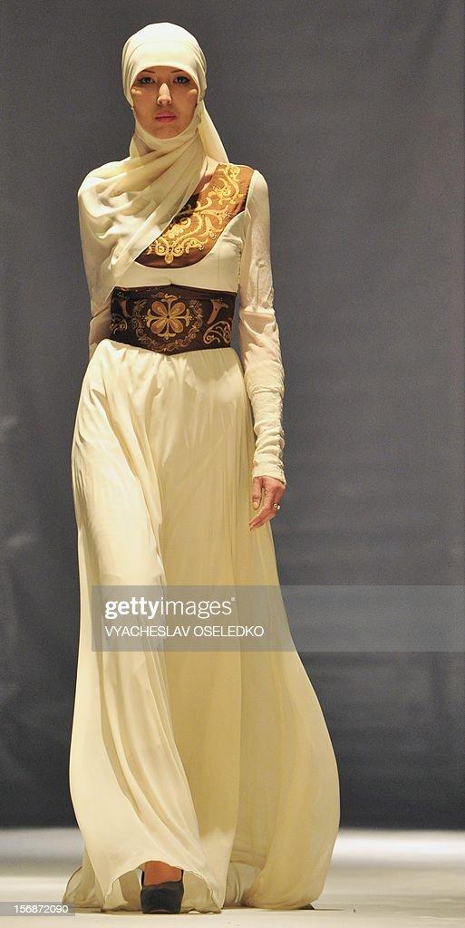 A model displays a creation by Kyrgyz designer Zhanara Chyngysheva during a Muslim fashion in the Kyrgyzstan's capital Bishkek, late on November 22, 2012.