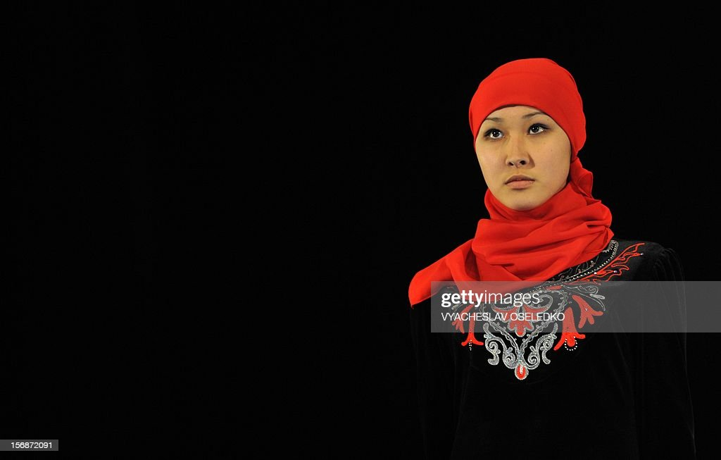 A model displays a creation by Kyrgyz designer Zhanara Chyngysheva during a Muslim fashion in the Kyrgyzstan's capital Bishkek, late on November 22, 2012. AFP PHOTO / VYACHESLAV OSELEDKO