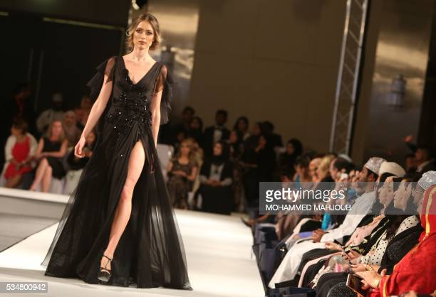 A model displays a creation by Lebanese designer Abed Mahfouz during the launch of the 4th edition of the Ladies a La Mode fashion show on May 27 in...