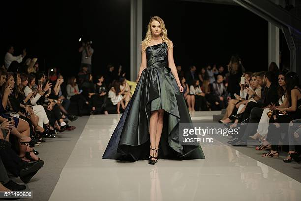 A model displays a creation by Lebanese designer Abed Mahfouz haute couture collection during 'La Mode a Beyrouth' fashion week in Beirut on April 19...
