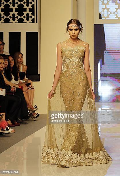 A model displays a creation by Lebanese designer Shady Zeineldine from his 'A Beryth 2016' collection during 'La Mode a Beyrouth' fashion week in...