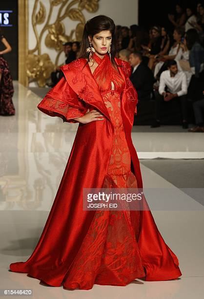 A model displays a creation by Lebanese fashion designer Fouad Sarkis during 'La Mode A Beyrouth' fashion week in the Lebanese capital on October 18...