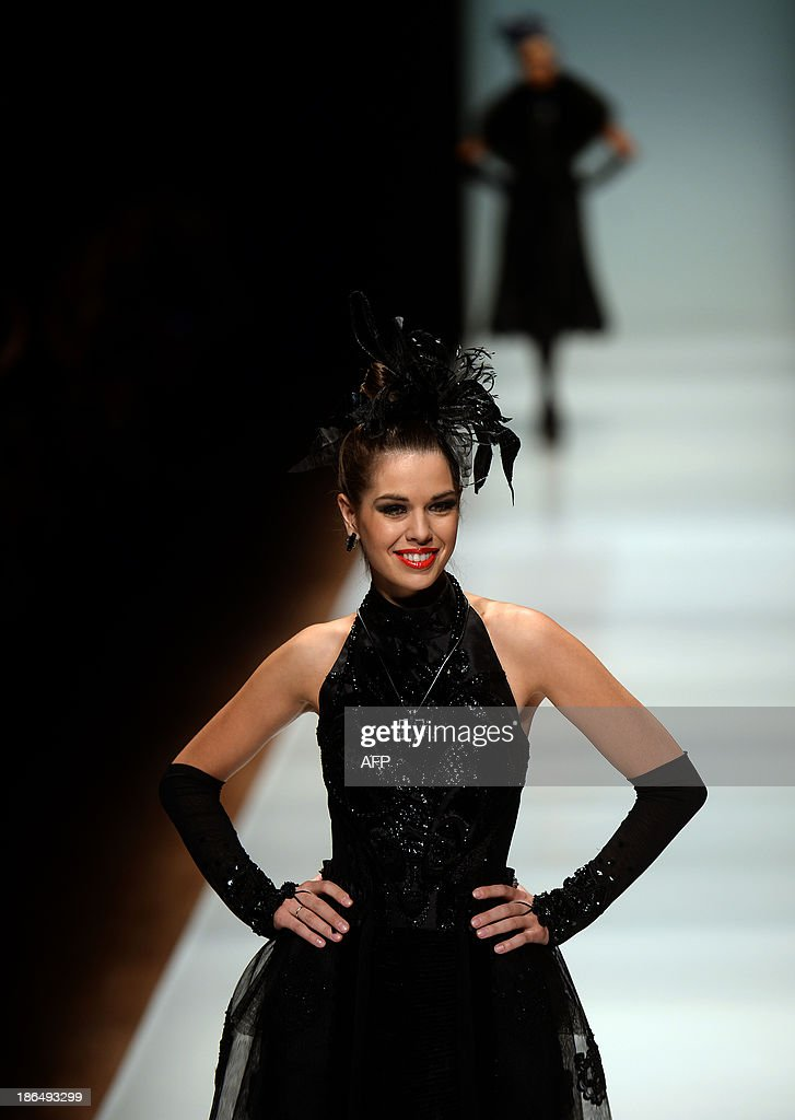 A model displays a creation by Russian designer Slava Zaitsev during the Russian Fashion Week in Moscow, on October 31, 2013. The Fashion Week takes place from October 25 to 31.