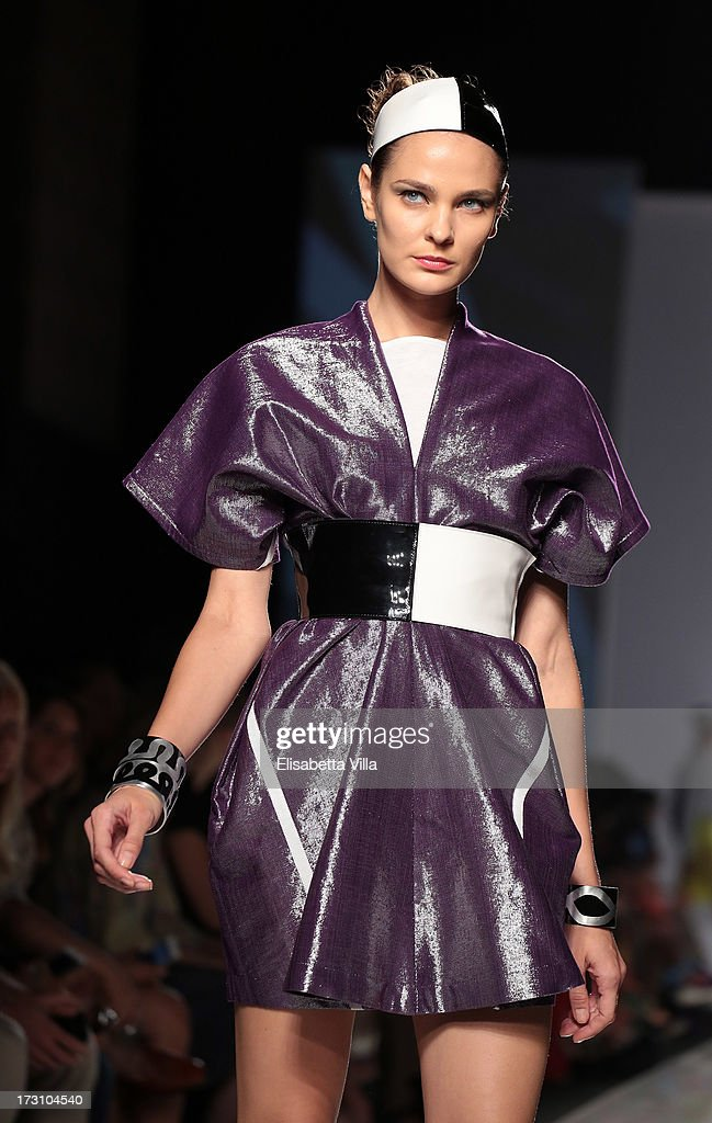 A model displays a creation by Sabine Portenier and Evelyne Roth during It's Ethical Fashion 'Bring Africa to Rome' catwalk collection S/S 2014 fashion show as part of AltaRoma AltaModa Fashion Week at Santo Spirito In Sassia on July 7, 2013 in Rome, Italy.