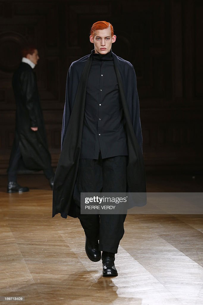 A model displays a creation by South Korean designer Songzio on January 19, 2013 during the men's fall-winter 2013-2014 fashion week in Paris.