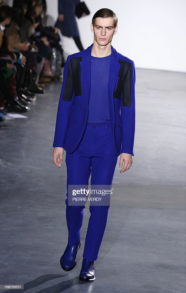 A model displays a creation by South Korean designer Young Mi Woo during the Wooyoungmi men's Fall-Winter 2013-2014 collection show on January 19, 2013 as part of the Men's fashion week in Paris.