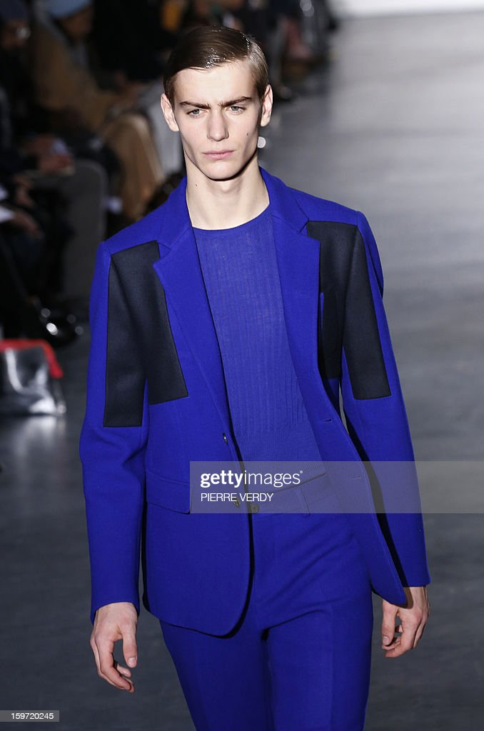 A model displays a creation by South Korean designer Young Mi Woo during the Wooyoungmi men's Fall-Winter 2013-2014 collection show on January 19, 2013 as part of the Men's fashion week in Paris. AFP PHOTO PIERRE VERDY