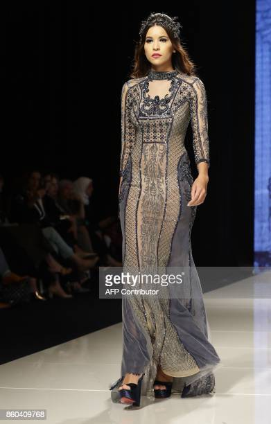 A model displays a creation by Syrian fashion designer Manal Ajaj during her fashion show 'Jasmin Goddess' in Beirut on October 11 2017 / AFP PHOTO /...