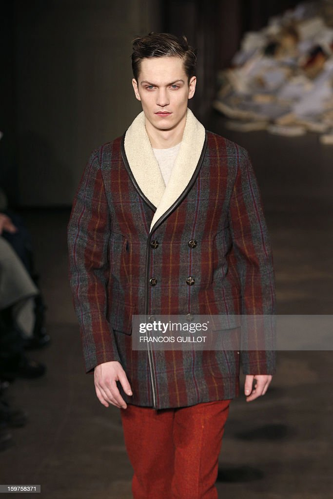 A model displays a creation by the label Melinda Gloss during the men's Fall-Winter 2013-2014 collection show on January 20, 2013 as part of the Men's fashion week in Paris. AFP PHOTO FRANCOIS GUILLOT