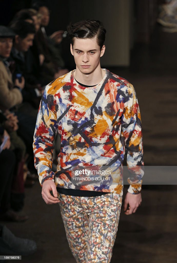 A model displays a creation by the label Melinda Gloss during the men's Fall-Winter 2013-2014 collection show on January 20, 2013 as part of the Men's fashion week in Paris.