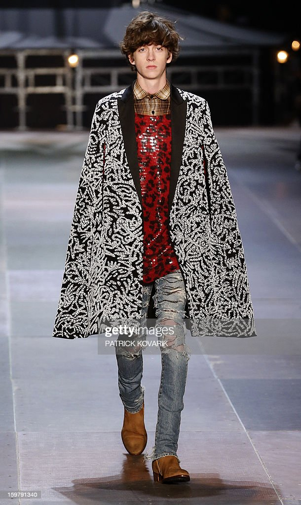 A model displays a creation by Yves Saint Laurent on January 20, 2013 during the men's fall-winter 2013-2014 fashion week in Paris.