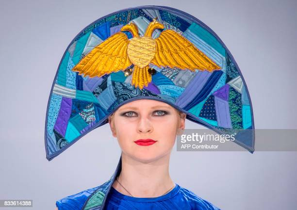 A model displays a creation featuring Russia's state emblem by Club Millinery during the international fashion fair Chapeau Mosfur 2017 in Moscow on...